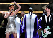 Jennifer performs in a metallic mini dress with decorative fringe.