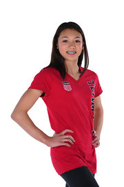 Kyla Ross wore a team USA red, white, and blue V-neck tee for her USOC portrait.