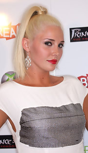 Karissa sported a super high ponytail with a hair-wrapped band for a polished finish.
