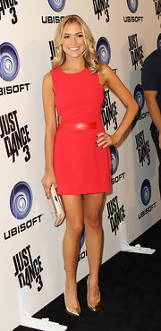 Kristin accessorized her red hot frock with metallic gold stilettos. The shiny shoes were the perfect touch of drama.