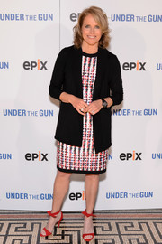 Underneath her cardigan, Katie Couric wore an abstract-print sheath dress.