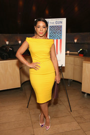 Selenis Leyva put on a curvy display in a form-fitting yellow off-the-shoulder dress at the New York premiere of 'Under the Gun.'