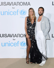 Heidi Klum was sexy-glam in a beaded, sheer-bottom gown by Azzaro Couture at the UNICEF Summer Gala.