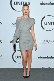 Toni Garrn was modern in a structured gray off-the-shoulder dress by Carmen March at the Unitas Gala Against Human Trafficking.