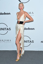Elsa Hosk teamed her dress with elegant gold sandals.