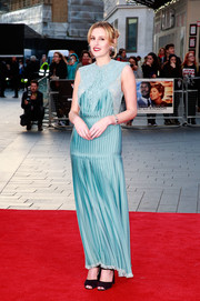 Laura Carmichael continued the vintage-chic vibe with a pair of dark-plum ankle-strap peep-toes.