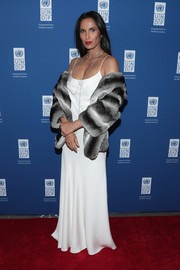 Padma Lakshmi got glam in a monochrome fur coat and a white silk gown for the UNDP Inaugural Global Goals Gala.