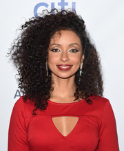 Mya attended the Universal Music Group Grammy after-party sporting a mass of tight curls.