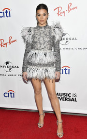 Hailee Steinfeld kept it fun in a feather-embellished silver dress by Giambattista Valli Couture at the 2019 Universal Music Group Grammy after-party.