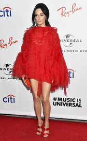 Kacey Musgraves complemented her frock with strappy red satin mules by Sophia Webster.