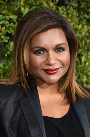 Mindy Kaling completed her bold beauty look with a sweep of red lipstick.