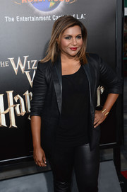 Mindy Kaling styled her black suit with a chic gold cuff bracelet for the opening of The Wizarding World of Harry Potter.