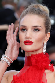 Rosie Huntington-Whiteley matched her earrings with a pair of Chanel diamond bracelets.