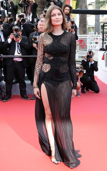 Laetitia Casta showed lots of skin in a sheer black Atelier Versace gown at the Cannes premiere of 'The Unknown Girl.'