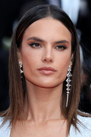 Alessandra Ambrosio accessorized with a pair of dangling diamond earrings by Boucheron for an ultra-glam finish.