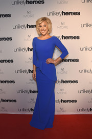 Savannah Chrisley got glam in an electric-blue column dress with asymmetrical peplum detailing for the Night of Freedom, A Tribute to the Legend George Michael.