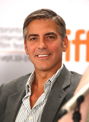 Clooney embraces his grey hair with this complementary grey suit.
