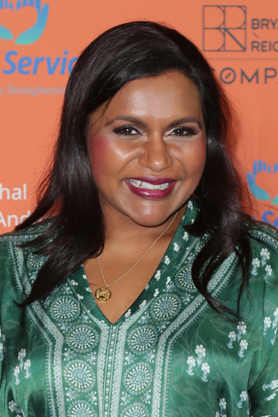 Mindy Kaling accessorized with a classic gold pendant.