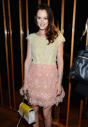 Leighton paired her Resort 2011 cocktail dress with a Cardboard Gene bag.
