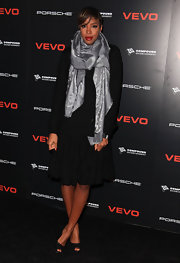 Kelly is bundled in a silver Louis Vuitton scarf.
