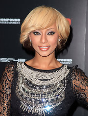 Singer Keri Hilson showed off her short blond bob, which featured brown undertones.