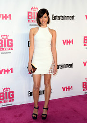 Aubrey Plaza put plenty of skin on display at the VH1 Big in 2015 Awards in a tiny white racer-neckline dress with a see-through panel on one hip.