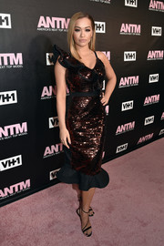 Rita Ora oozed ultra-feminine appeal wearing this sequined and ruffled cocktail dress by Johanna Ortiz at the 'America's Next Top Model' premiere party.