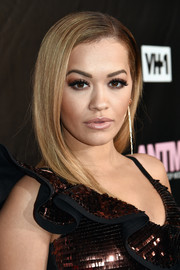Rita Ora kept it simple yet elegant with this straight side-parted style at the 'America's Next Top Model' premiere party.