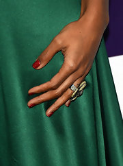 Paired against an emerald green dress, Kelly's red sparkly nails were just right for the season.