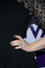 Gold and silver foil made Demi's dark mani all the more glam.