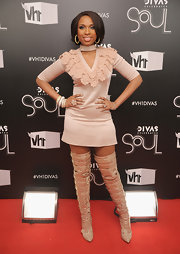 Jennifer Hudson went for a futuristic red carpet look in buckled gold over-the-knee boots.