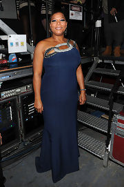 Queen Latifah wore a navy evening dress with a bedazzled neckline for the VH1 Divas celebration.
