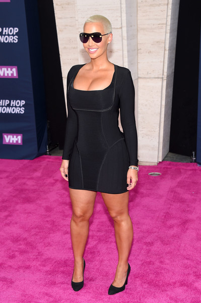 Amber Rose's famous curves were almost bursting out of her black bandage dress as she walked the VH1 Hip Honors pink carpet!