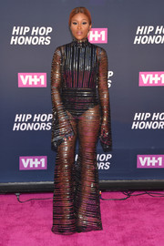 Eve put on a daring display in a sheer, striped jumpsuit by Michael Halpern at the VH1 Hip Hop Honors.