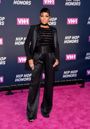 Monica struck the perfect balance between mannish and sexy with this black Rebecca Vallance pantsuit and sheer top combo at the VH1 Hip Hop Honors.
