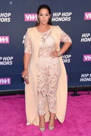 Dascha Polanco covered up just a bit with a sleeveless nude duster, also by Marco Hall.