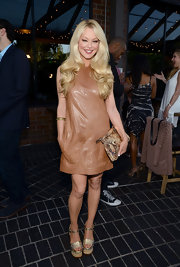 Charlotte Ross kept her look simple but chic with this light brown leather shift dress.