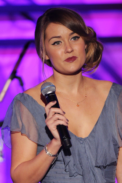 Lauren Conrad has the cat eye look down. Keeping her eyeshadow neutral, she uses liquid liner to extend the line for a distinctively retro look.