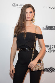 Bianca Balti gave her black outfit a heavy dose of sparkle with this bejeweled chain-strap bag during the VIBES by Sports Illustrated Swimsuit 2017 launch.