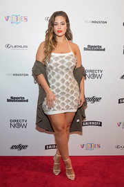 Ashley Graham paired her sexy frock with strappy nude heels.