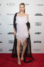 Barbara Palvin pulled her look together with a pair of strappy nude sandals.