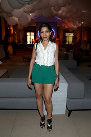 Freida Pinto styled her outfit with a pair of black and silver Ferragamo sandals.