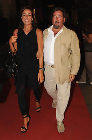 Cristina Parodi's sparsely-strapped sandals showed off her elegant feet as she attended Cavalli's Fashion Night Out.