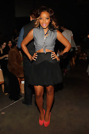 Angela Simmons topped off her look with bright coral platform pumps.