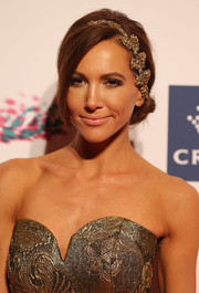 Kyly Clarke looked romantic with her loose chignon, complete with a lovely headband, at the VRC Oaks Club luncheon.