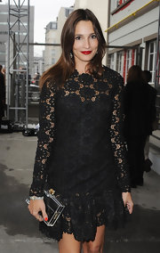 Astrid Munoz showed off a lace-clad dress while attending the Valentino show.