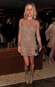 Chloe Sevigny stuck to neutrals in nude leather ankle boots.