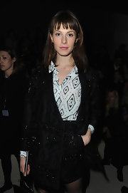 Elettra Wiedemann worked it in a beaded black short suit at the Valentino fashion show.