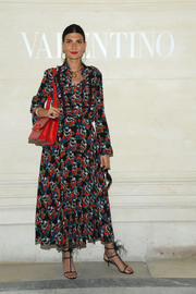 Giovanna Battaglia completed her outfit with feather-embellished T-strap sandals.
