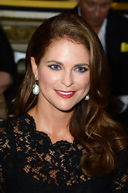Princess Madeleine's red lips added instant glamour to her beauty look.
